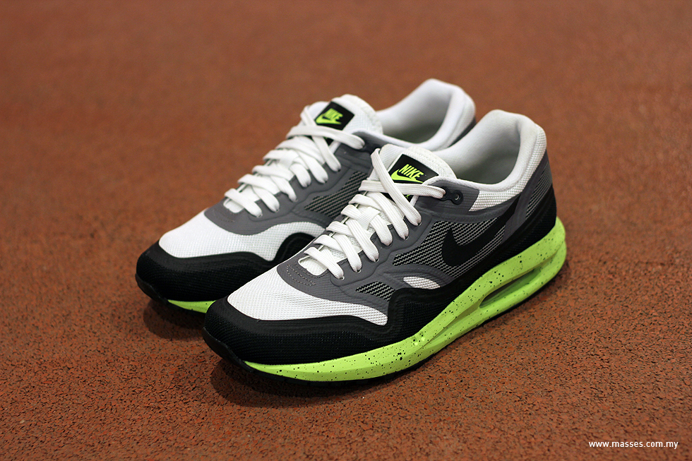 quality design 60792 adb5d The Nike Air Max 1 Lunarlon features a Lunarlon midsole that's covered with  black-speckled volt, and the ripstop upper which's mixed with black  mudguard, ...