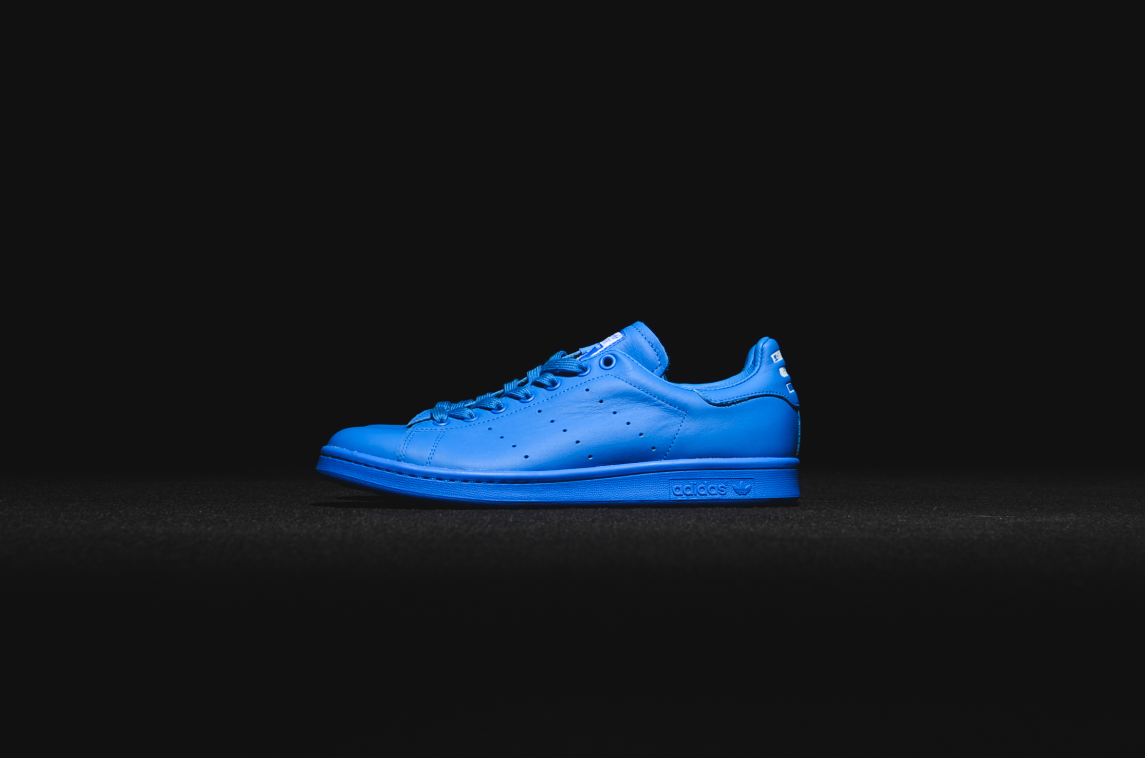 purchase cheap 233fe 64597 ... Stan Smith in full red, black and blue colour ways. The shoes sport a  leather upper as well as outsole, a beefed up tongue tag, three stripes on  the ...